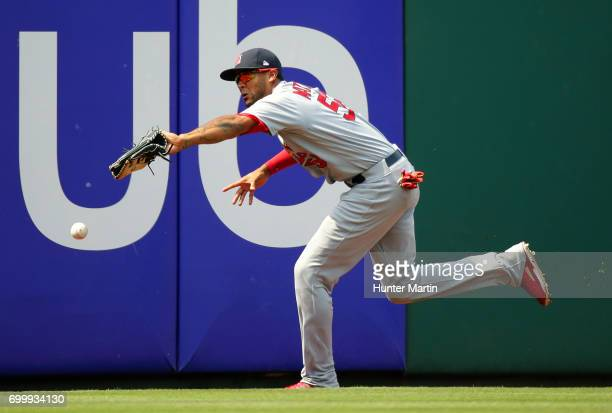 Jose Martinez of the St Louis Cardinals misplays a fly ball for an error in the eighth inning during a game against the Philadelphia Phillies at...