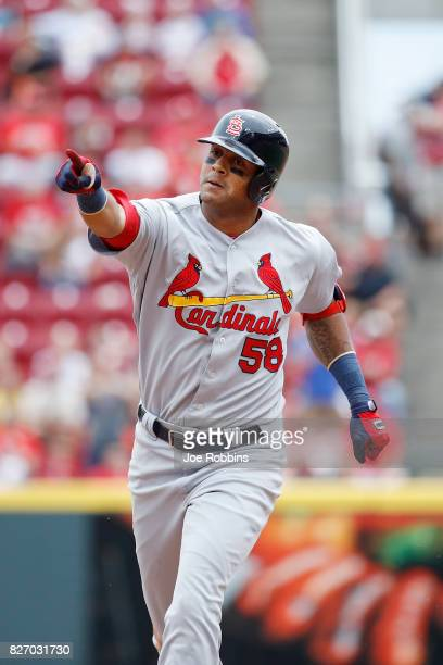 Jose Martinez of the St Louis Cardinals reacts as he rounds the bases after hitting a grand slam home run in the fourth inning of a game against the...