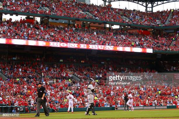 Jose Martinez of the St Louis Cardinals rounds the bases after hitting a tworun home run against the Pittsburgh Pirates in the second inning at Busch...