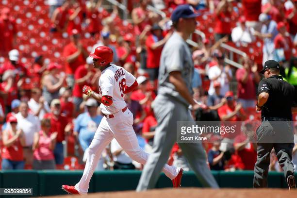 Jose Martinez of the St Louis Cardinals runs the bases after hitting a solo home run during the fifth inning at Busch Stadium on June 13 2017 in St...