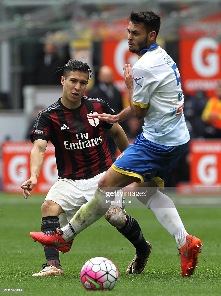 Jose Mauri of AC Milan is challenged by Mirko Gori of Frosinone Calcio during the Serie A match between AC Milan and Frosinone Calcio at Stadio Giuseppe Meazza on May 1, 2016 in Milan, Italy.
