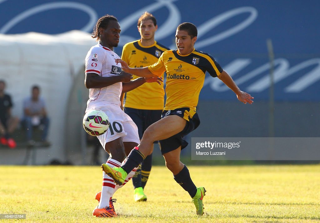 Jose Mauri (R) of Parma competes for the ball with Jerry Mbakogu (R) of Carpi FC at Stadio Sandro Cabassi on August 23, 2014 in Carpi, Italy.