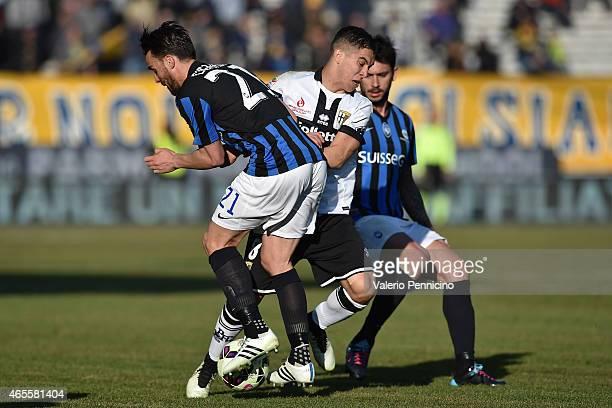 Jose Mauri of Parma FC clashes with Luca Cigarini of Atalanta BC during the Serie A match between Parma FC and Atalanta BC at Stadio Ennio Tardini on...
