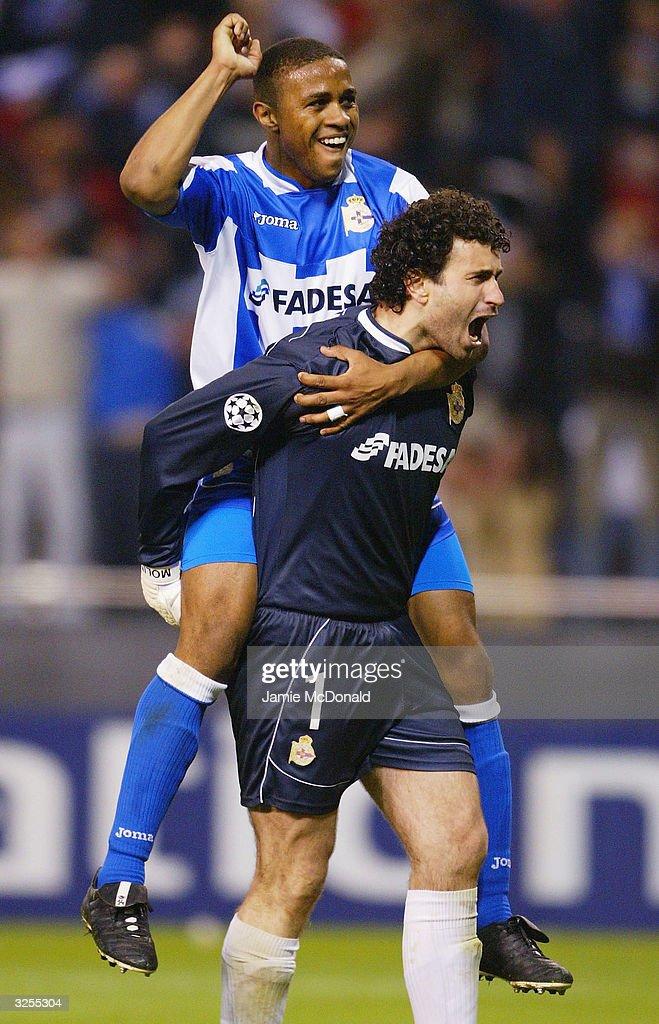 Jose Molina and Jorge Andrade of Deportivo celebrate during the UEFA Champions League match between Deportivo La Coruna and AC Milan at the Estadio Municipal de Riazor on April 7, 2004 in La Coruna.