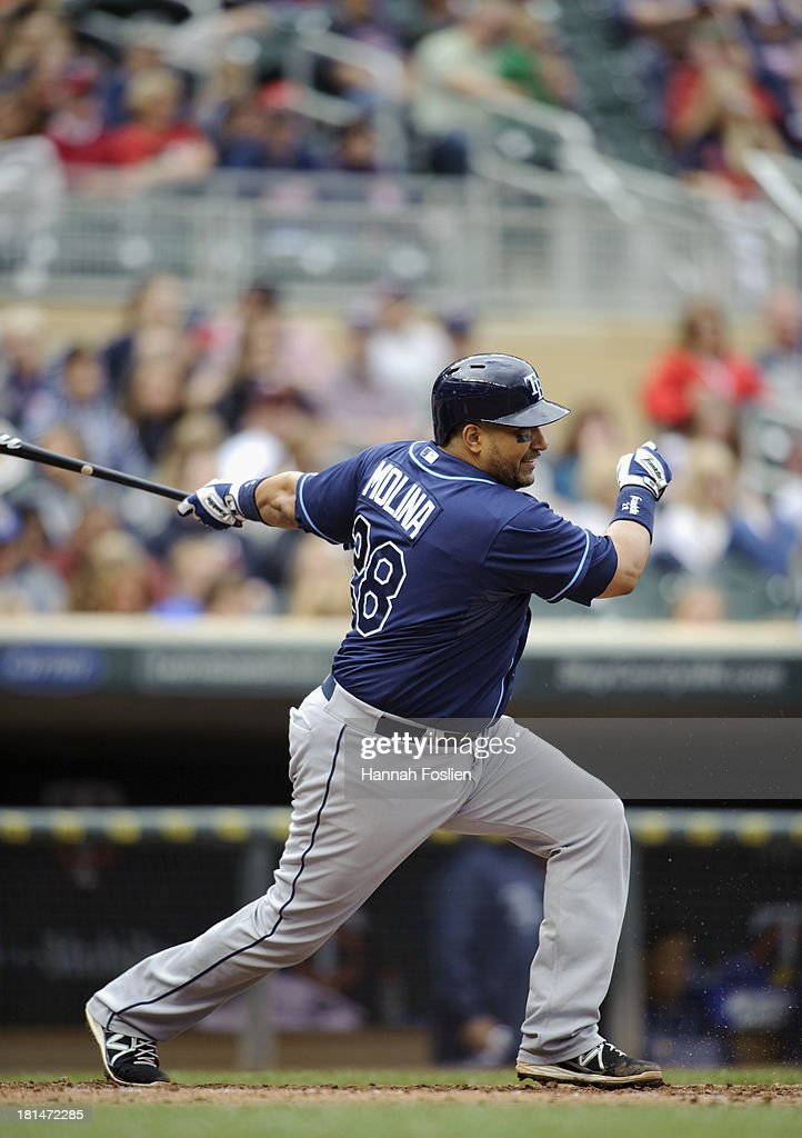 Jose Molina #28 of the Tampa Bay Rays bats against the Minnesota Twins during the game on September 15, 2013 at Target Field in Minneapolis, Minnesota.