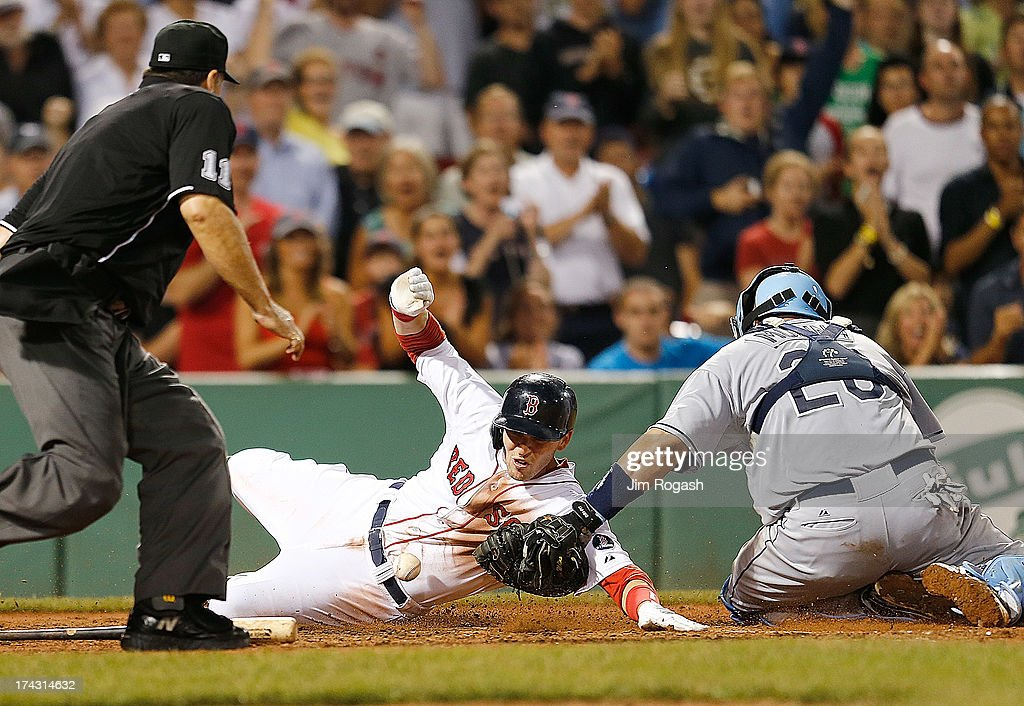 Jose Molina #28 of the Tampa Bay Rays drops the ball as <a gi-track='captionPersonalityLinkClicked' href=/galleries/search?phrase=Stephen+Drew&family=editorial&specificpeople=757520 ng-click='$event.stopPropagation()'>Stephen Drew</a> #7 of the Boston Red Sox scores in the 8th inning at Fenway Park on July 23, 2013 in Boston, Massachusetts.