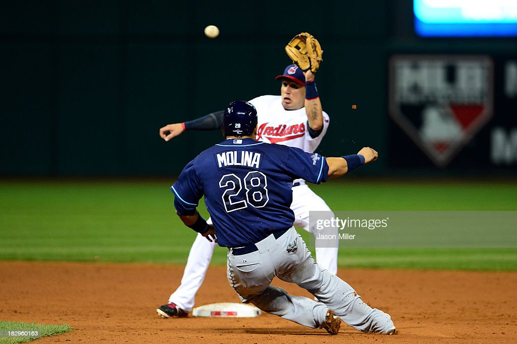 Jose Molina #28 of the Tampa Bay Rays gets tagged out by Asdrubal Cabrera #13 of the Cleveland Indians to end the top outfield the fifth inning during the American League Wild Card game at Progressive Field on October 2, 2013 in Cleveland, Ohio.