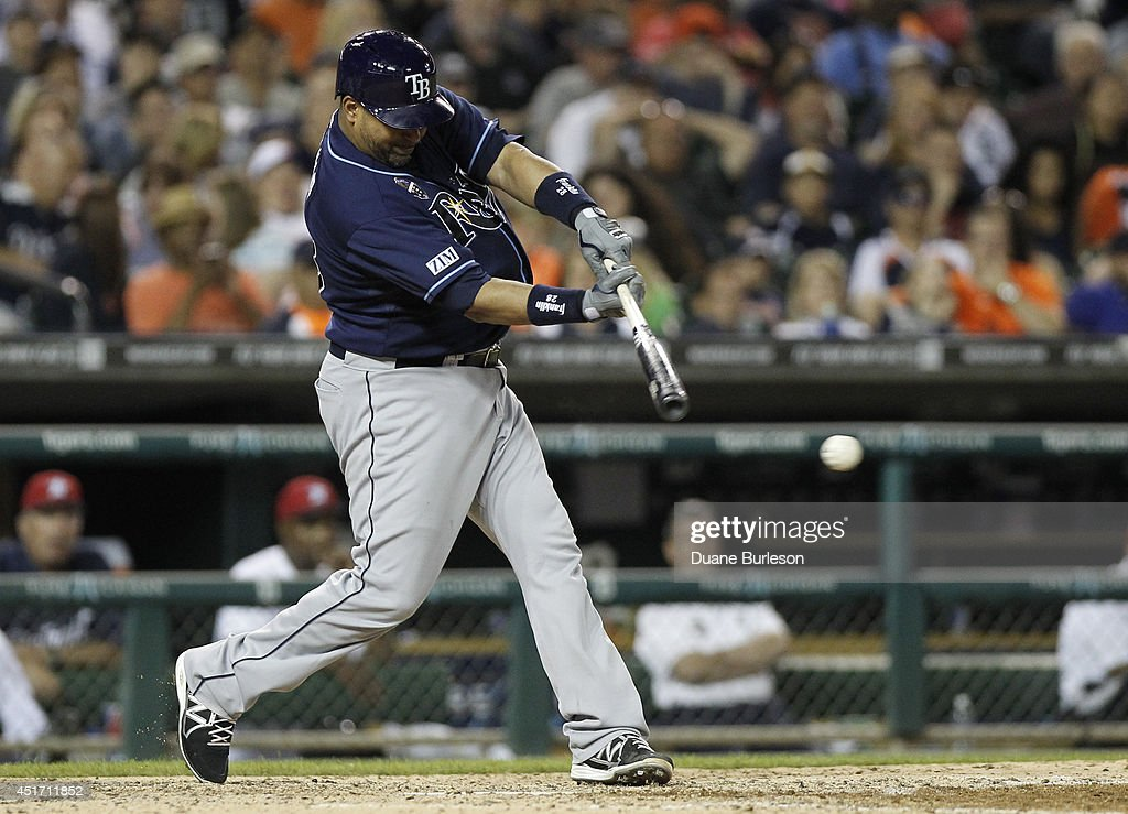 <a gi-track='captionPersonalityLinkClicked' href=/galleries/search?phrase=Jose+Molina&family=editorial&specificpeople=206365 ng-click='$event.stopPropagation()'>Jose Molina</a> #28 of the Tampa Bay Rays singles against the Detroit Tigers during the eighth inning at Comerica Park on July 4, 2014 in Detroit, Michigan. The Rays defeated the Tigers 6-3.