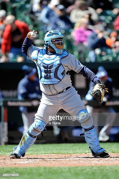 Jose Molina of the Tampa Bay Rays throws the ball to second base against the Baltimore Orioles at Oriole Park at Camden Yards on April 16 2014 in...