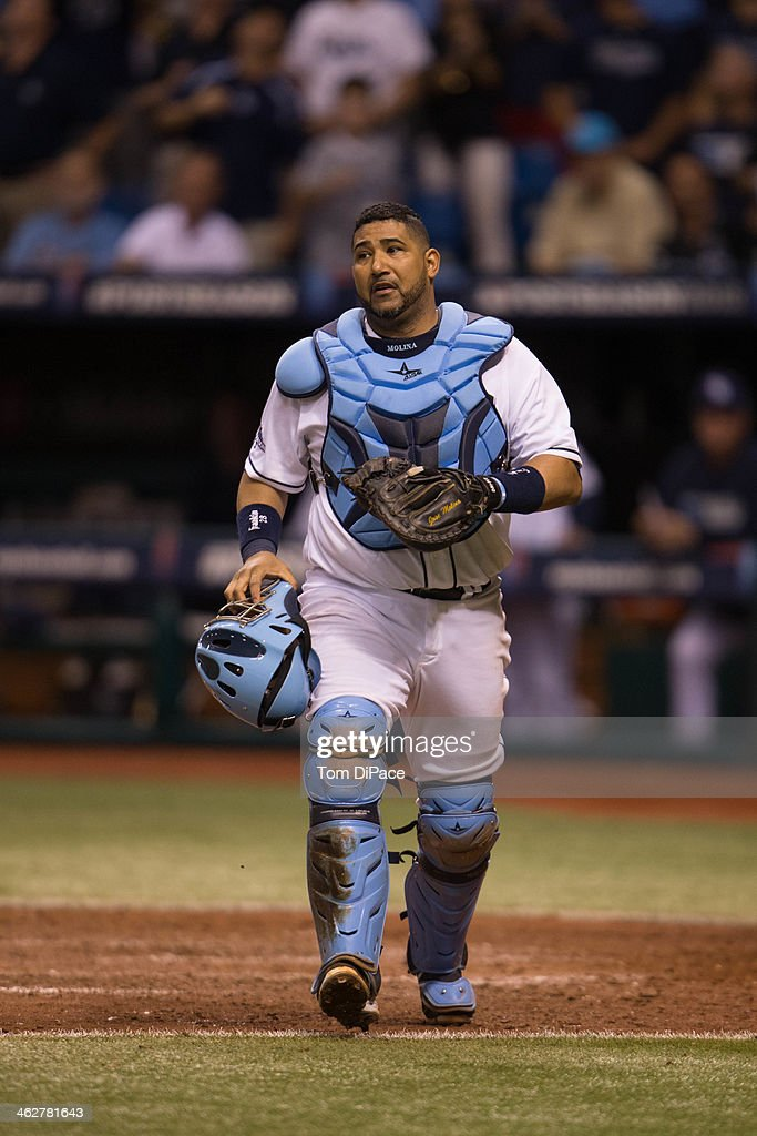 Jose Molina #28 of the Tampa Bay Rays walks back to the dugout during Game 3 of the American League Division Series against the Boston Red Sox at Tropicana Field on Monday, October 7, 2013 in St. Petersburg, Florida.