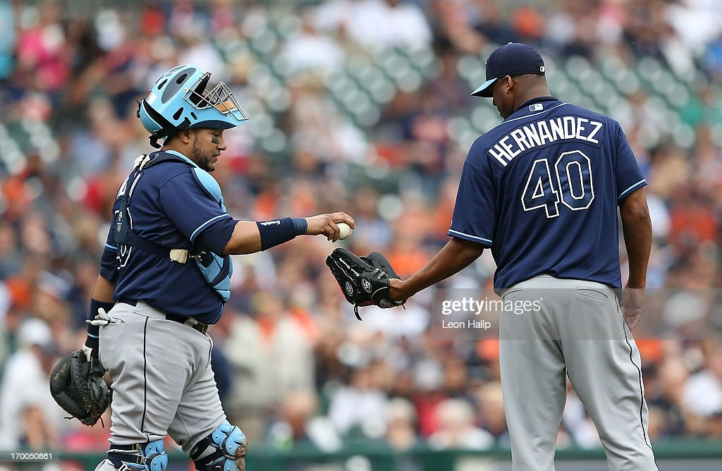 <a gi-track='captionPersonalityLinkClicked' href=/galleries/search?phrase=Jose+Molina&family=editorial&specificpeople=206365 ng-click='$event.stopPropagation()'>Jose Molina</a> #28 of the Tampa Bay Rays walks to the mound to talk with teammate Roberto Hernandez #40 during the fifth inning of the game against the Detroit Tigers at Comerica Park on June 6, 2013 in Detroit, Michigan. The Tigers defeated the Rays 5-2.