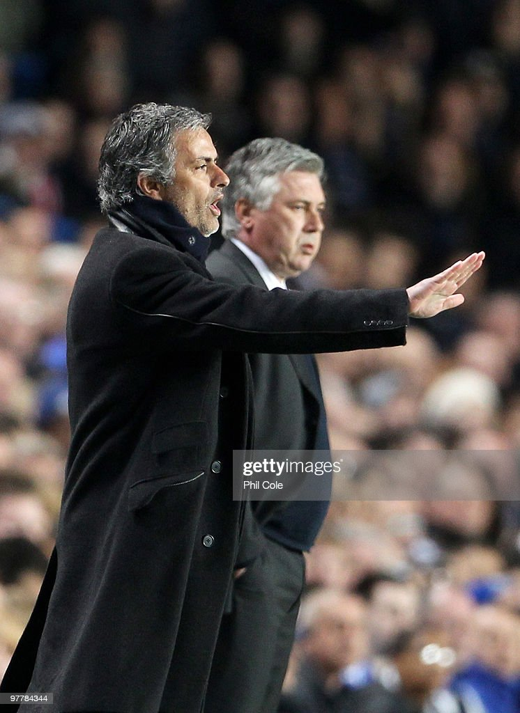 Jose Mourinho, Coach of Inter Milan gives instructions as <a gi-track='captionPersonalityLinkClicked' href=/galleries/search?phrase=Carlo+Ancelotti&family=editorial&specificpeople=226747 ng-click='$event.stopPropagation()'>Carlo Ancelotti</a>, Manager of Chelsea looks on during the UEFA Champions League Round of 16 second leg match between Chelsea and Inter Milan at Stamford Bridge on March 16, 2010 in London, England.