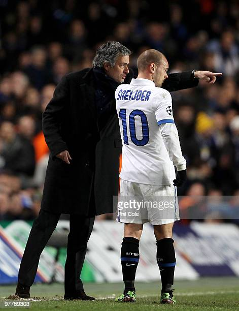 Jose Mourinho Coach of Inter Milan gives instructions to Wesley Sneijder of Inter Milan during the UEFA Champions League Round of 16 second leg match...