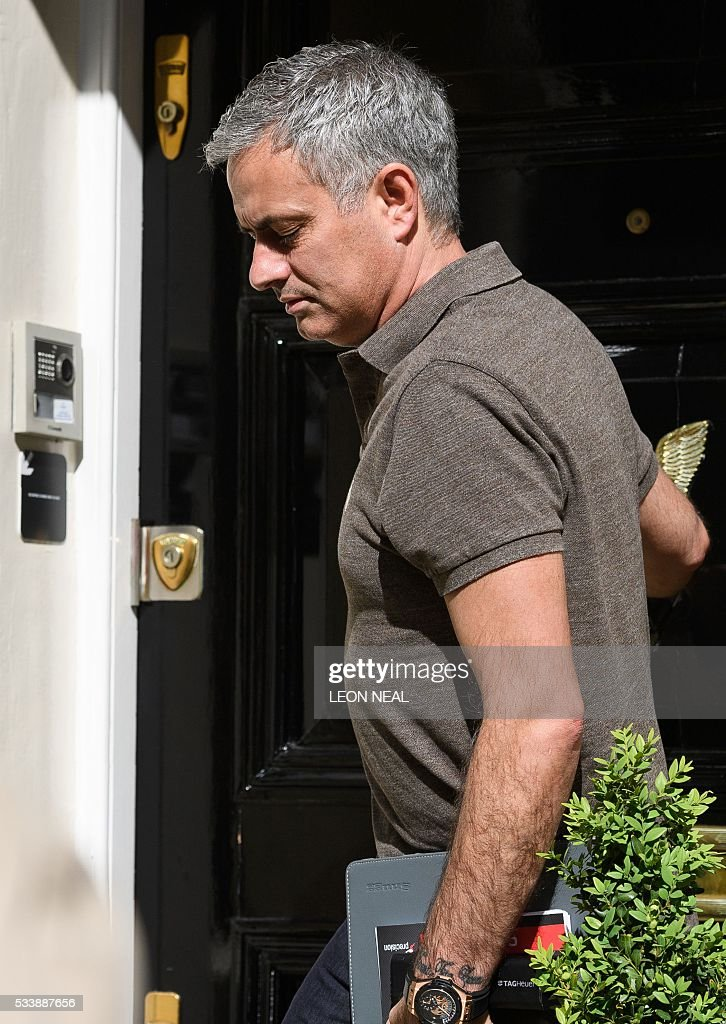 Jose Mourinho is pictured as he leaves his home in London on May 24, 2016. Mourinho is on the verge of fulfilling his dream of managing Manchester United after Louis van Gaal's troubled two-year reign at Old Trafford came to a bitter end. Van Gaal said he was 'very disappointed' to be sacked on May 23, just 48 hours after leading United to victory in the FA Cup final against Crystal Palace. / AFP / LEON