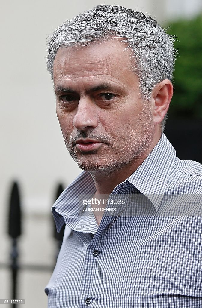 Jose Mourinho leaves his home in central London on May 25, 2016. Manchester United were locked in a second day of talks with Jose Mourinho's agents on Wednesday, hammering out a deal to sweep the controversial Portuguese boss into Old Trafford. / AFP / ADRIAN