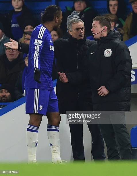 Jose Mourinho manager of Chelsea and Didier Drogba of Chelsea appeal to the fourth official during the FA Cup Third Round match between Chelsea and...