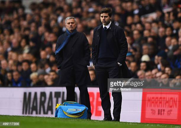 Jose Mourinho manager of Chelsea and Mauricio Pochettino manager of Tottenham Hotspur look on during the Barclays Premier League match between...
