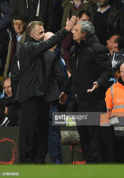 Jose Mourinho manager of Chelsea appeals to fourth official Jonathan Moss as he is sent off during the Barclays Premier League match between Aston...