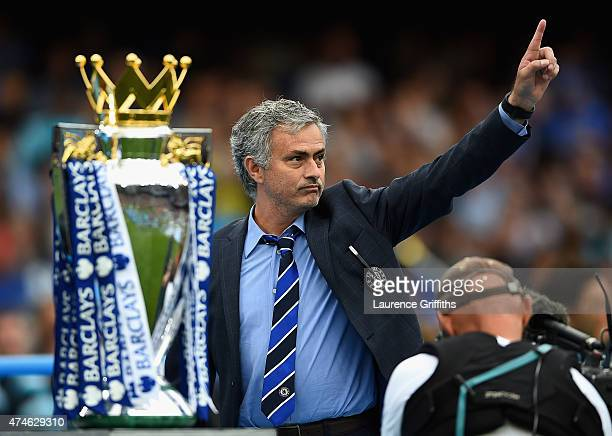 Jose Mourinho manager of Chelsea celebrates the Premier League title after the Barclays Premier League match between Chelsea and Sunderland at...