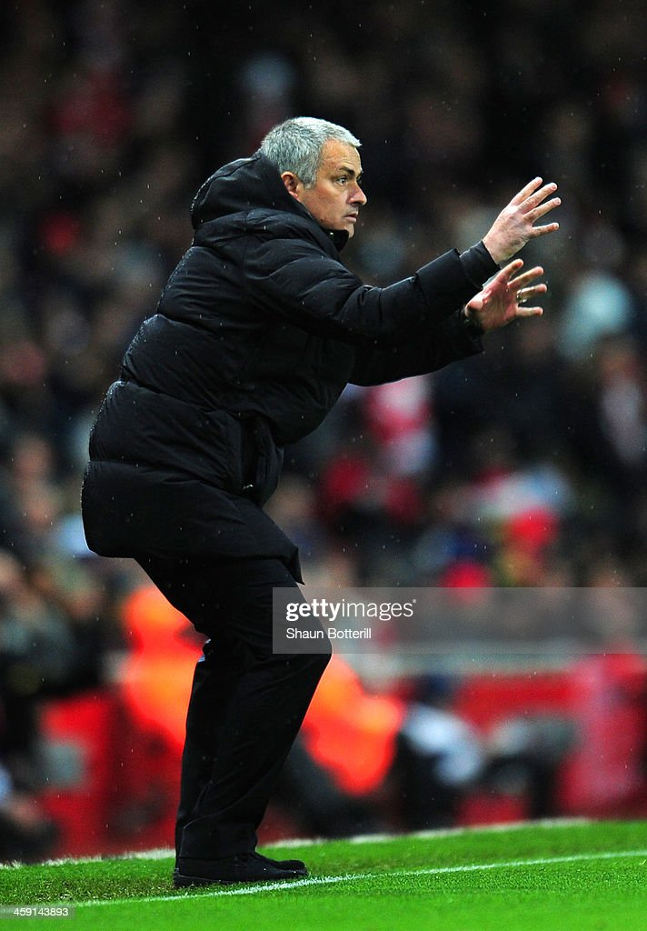 Jose Mourinho manager of Chelsea gives instructions during the Barclays Premier League match between Arsenal and Chelsea at Emirates Stadium on December 23, 2013 in London, England.