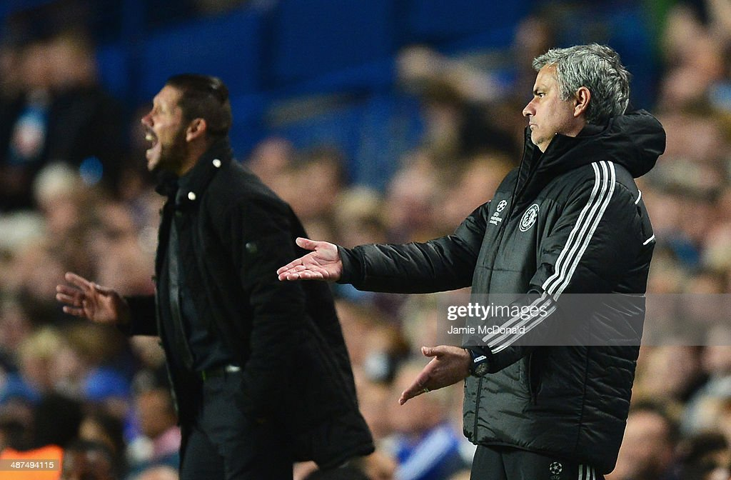 Jose Mourinho, manager of Chelsea reacts with Diego Simeone, coach of Club Atletico de Madrid during the UEFA Champions League semi-final second leg match between Chelsea and Club Atletico de Madrid at Stamford Bridge on April 30, 2014 in London, England.