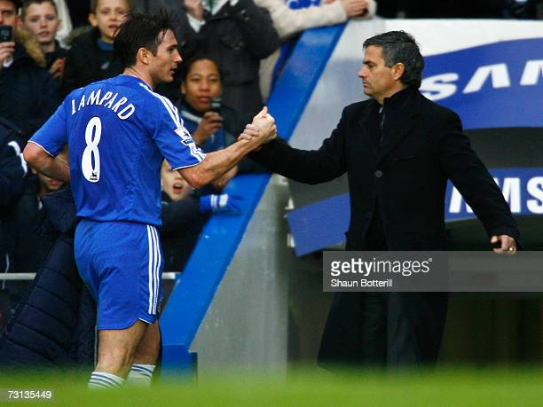 Jose Mourinho manager of Chelsea shakes hands with Frank Lampard as he is substituted during the FA Cup sponsored by EON 4th Round match between...