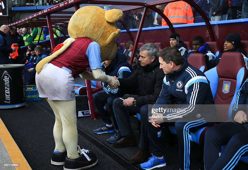 Jose Mourinho, Manager of Chelsea shakes hands with the Villa mascot during the Barclays Premier League match between Aston Villa and Chelsea at Villa Park on February 7, 2015 in Birmingham, England.