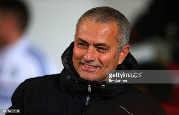 Jose Mourinho manager of Chelsea smiles during the Barclays Premier League match between West Ham United and Chelsea at Boleyn Ground on November 23...