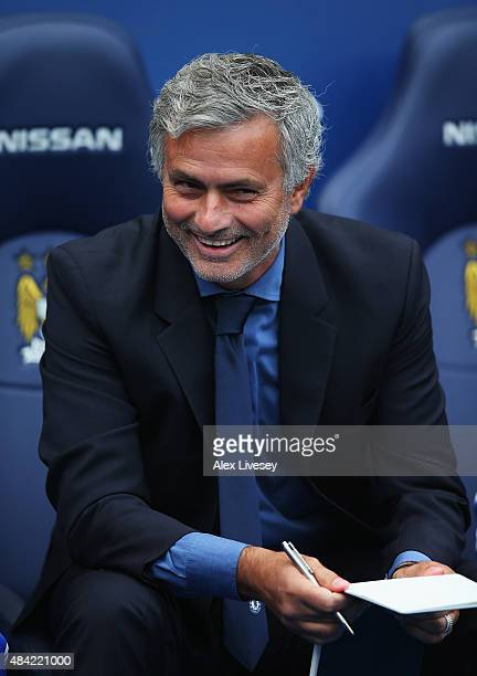 Jose Mourinho manager of Chelsea smiles during the Barclays Premier League match between Manchester City and Chelsea at the Etihad Stadium on August...