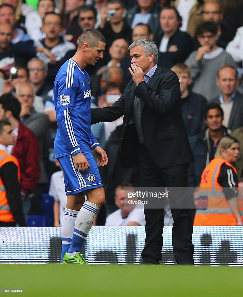 Jose Mourinho manager of Chelsea talks to <a gi-track='captionPersonalityLinkClicked' href=/galleries/search?phrase=Fernando+Torres&family=editorial&specificpeople=194755 ng-click='$event.stopPropagation()'>Fernando Torres</a> of Chelsea after he is sent off during the Barclays Premier League match between Tottenham Hotspur and Chelsea at White Hart Lane on September 28, 2013 in London, England.