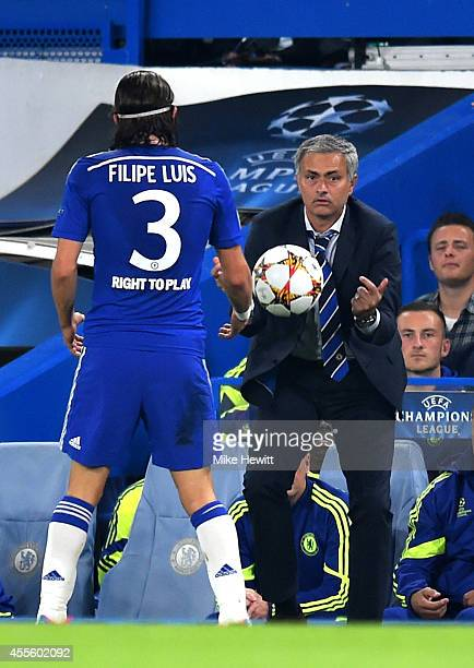 Jose Mourinho manager of Chelsea throws the ball back to Filipe Luis of Chelsea during the UEFA Champions League Group G match between Chelsea and FC...