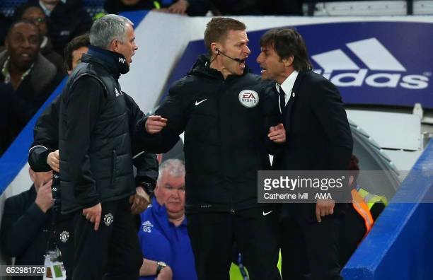 Jose Mourinho Manager of Manchester United and Antonio Conte manager of Chelsea have words and are separated by fourth official Mike Jones during The...
