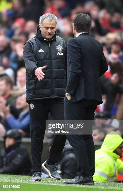 Jose Mourinho Manager of Manchester United and Antonio Conte Manager of Chelsea shake hands after the Premier League match between Manchester United...