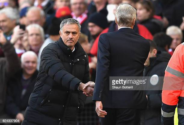 Jose Mourinho Manager of Manchester United and Arsene Wenger Manager of Arsenal shake hands prior to kick off during the Premier League match between...