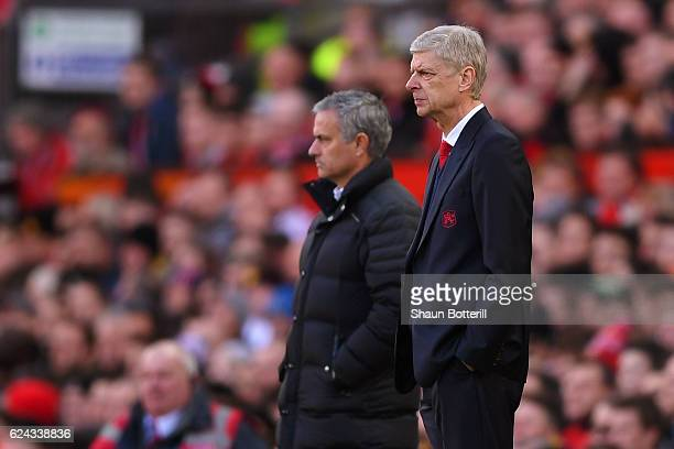 Jose Mourinho Manager of Manchester United and Arsene Wenger Manager of Arsenal both look on during the Premier League match between Manchester...
