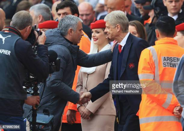Jose Mourinho Manager of Manchester United and Arsene Wenger Manager of Arsenal shake hands prior to the Premier League match between Arsenal and...