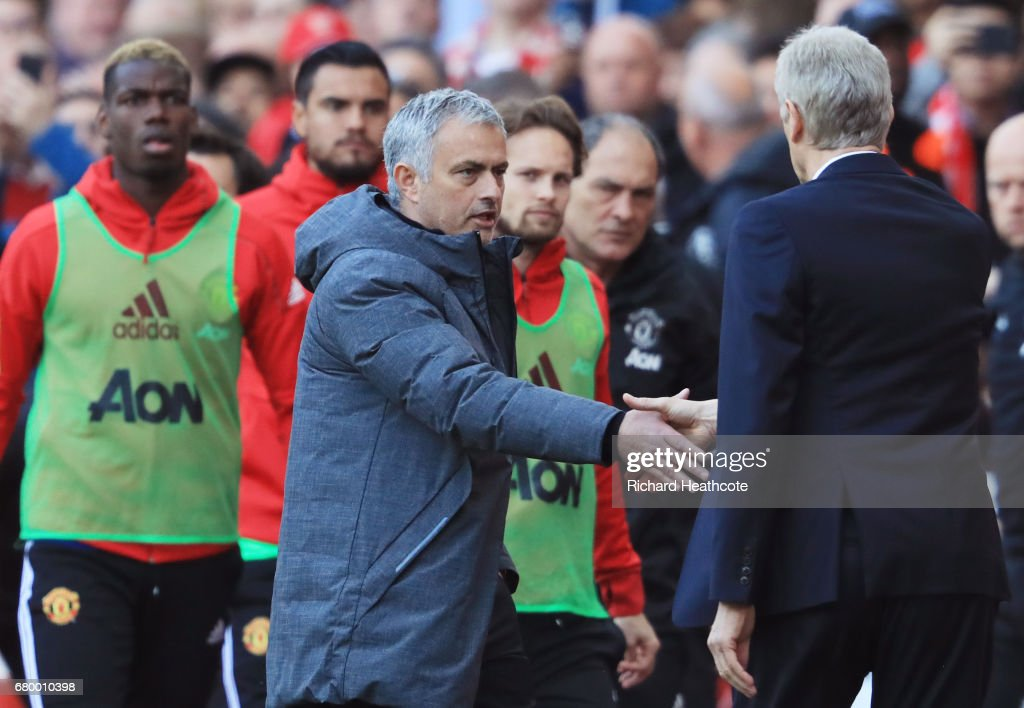 Jose Mourinho, Manager of Manchester United and Arsene Wenger, Manager of Arsenal shake hands after the Premier League match between Arsenal and Manchester United at the Emirates Stadium on May 7, 2017 in London, England.