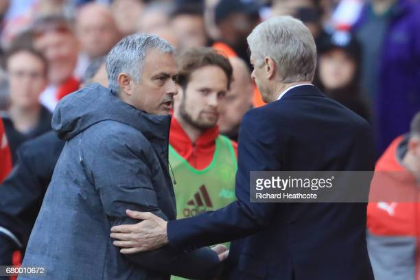 Jose Mourinho Manager of Manchester United and Arsene Wenger Manager of Arsenal shake hands after the Premier League match between Arsenal and...