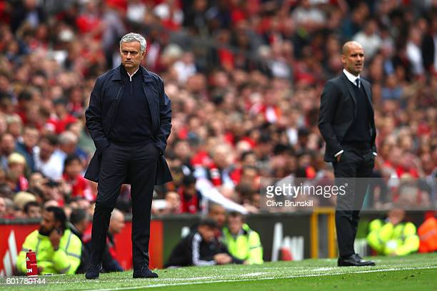 Jose Mourinho Manager of Manchester United and Josep Guardiola Manager of Manchester City look on during the Premier League match between Manchester...