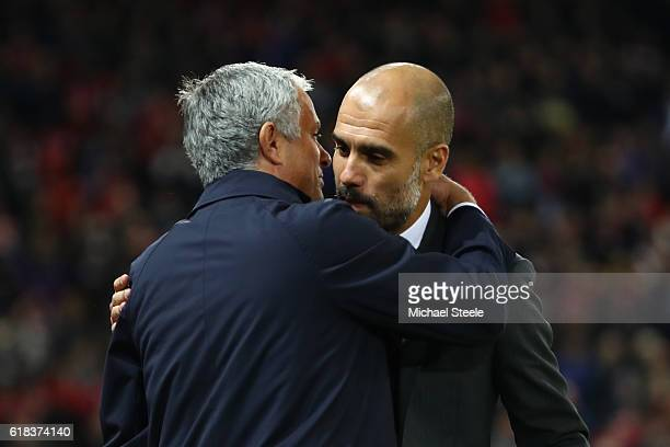 Jose Mourinho Manager of Manchester United and Josep Guardiola Manager of Manchester City embrace prior to kick off during the EFL Cup fourth round...