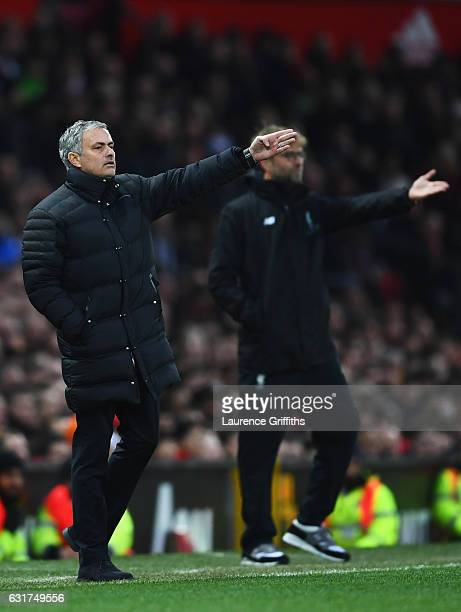 Jose Mourinho manager of Manchester United and Jurgen Klopp manager of Liverpool appeal during the Premier League match between Manchester United and...