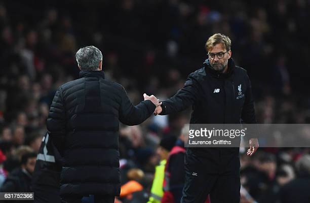 Jose Mourinho manager of Manchester United and Jurgen Klopp manager of Liverpool shake hands after the Premier League match between Manchester United...