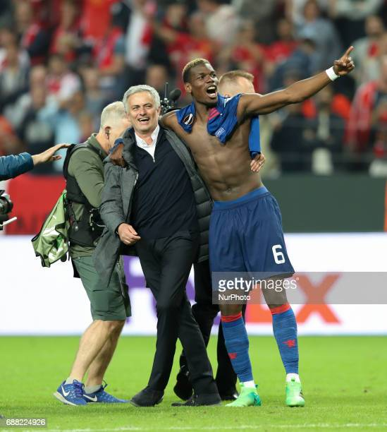 Jose Mourinho Manager of Manchester United and Paul Pogba celebrate victory following the UEFA Europa League Final between Ajax and Manchester United...