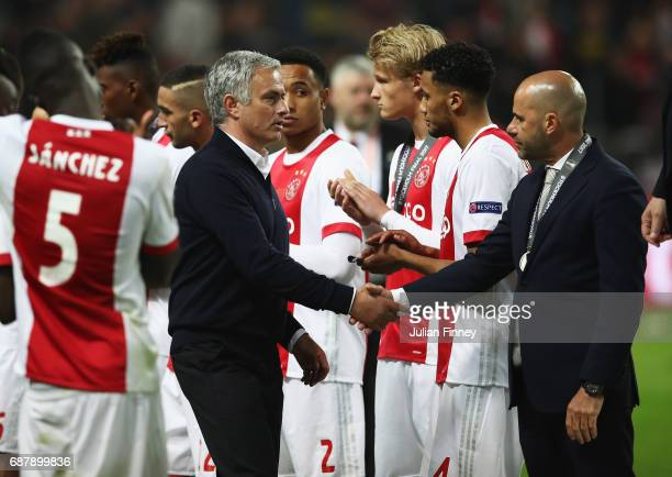 Jose Mourinho Manager of Manchester United and Peter Bosz Manager of Ajax shake hands following the UEFA Europa League Final between Ajax and...