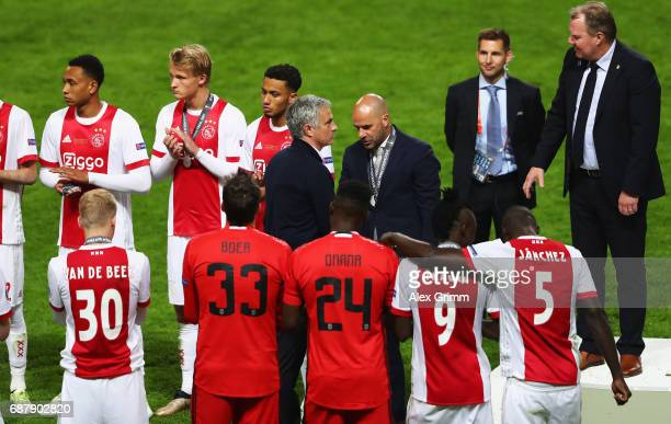 Jose Mourinho Manager of Manchester United and Peter Bosz Manager of Ajax shake hands after the UEFA Europa League Final between Ajax and Manchester...