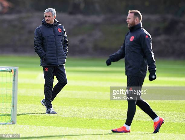 Jose Mourinho manager of Manchester United and Wayne Rooney look on during a Manchester United training session on the eve of their UEFA Europa...