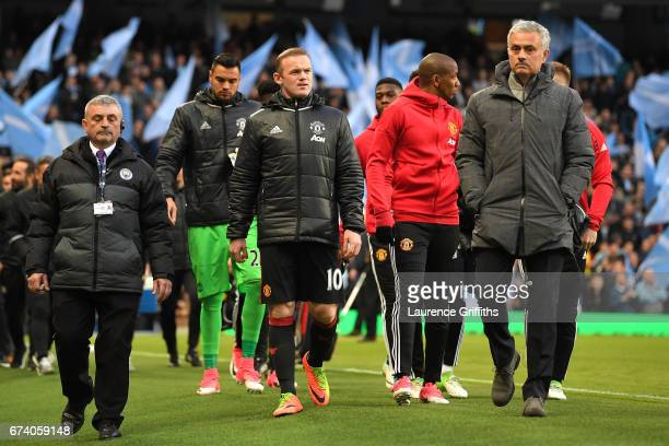 Jose Mourinho Manager of Manchester United and Wayne Rooney make their way to the dougouts during the Premier League match between Manchester City...