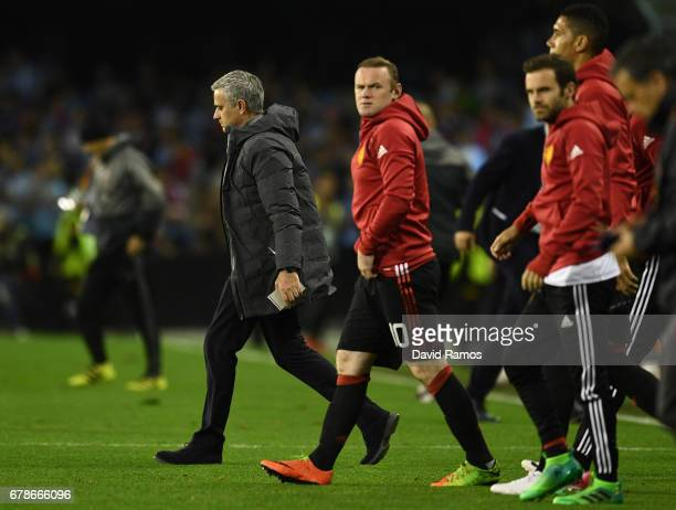 Jose Mourinho manager of Manchester United and Wayne Rooney of Manchester United look on at half time during the UEFA Europa League semi final first...