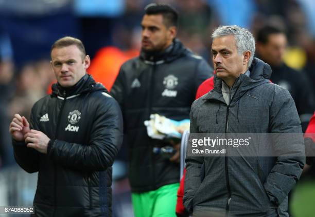 Jose Mourinho Manager of Manchester United and Wayne Rooney of Manchester United make their way to the bench during the Premier League match between...