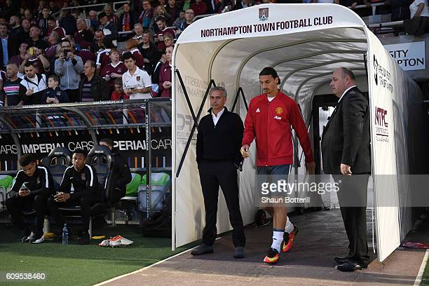 Jose Mourinho Manager of Manchester United and Zlatan Ibrahimovic of Manchester United make their way out of the tunnel during the EFL Cup Third...